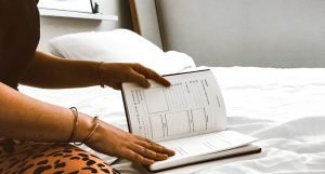 Photo of a woman's hands holding an open journal